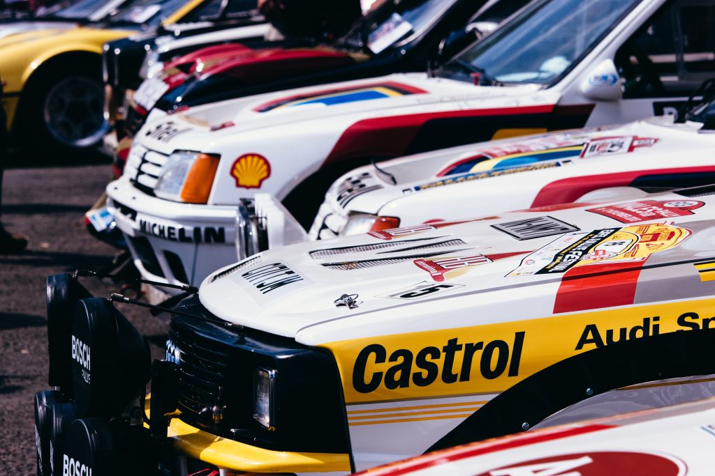 Race cars with vinyl decals. Photo by: Alex Holyoake on Unsplash