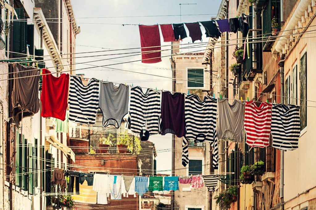 An assortment of T-shirts on a An assortment of T-shirts hanging on a lineline